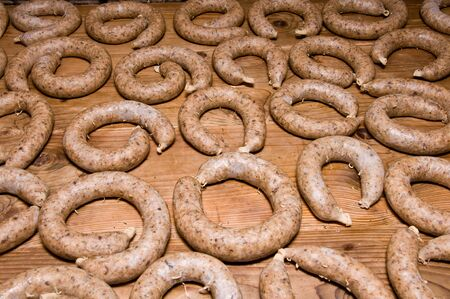 Horizontal view on wooden table full of curly liverwurst Stock Photo - 10848223