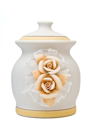 clay flowers on pottery jar isolated on white photo