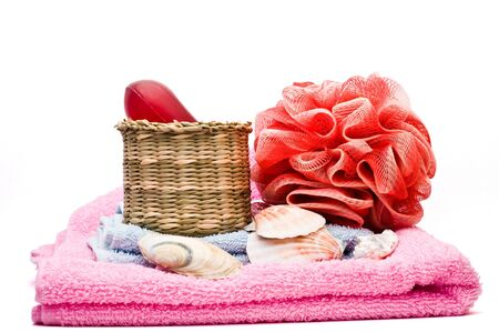 Bathroom decoration on two towels isolated on white