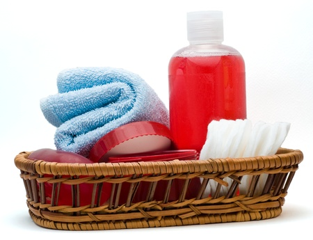 Bathroom accessories prepared in a basket isolated on white
