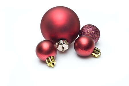Four Christmas ball decorations isolated on white photo