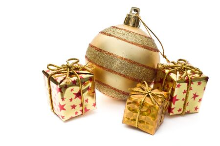 pack string: Golden christmas decoration with gift boxes isolated on white Stock Photo