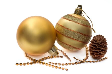 Golden glass spheres and christmas decoration isolated on white photo
