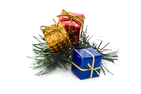 pack string: Three small gift boxes on pine branch isolated on white Stock Photo
