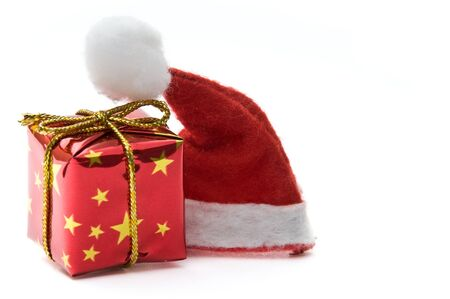 Santa hat and gift box isolated on white photo