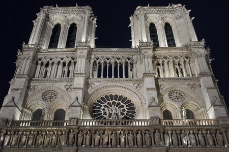 Night view of the facade of Notre Dame in Paris, France Stock Photo