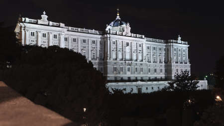 Night view of the right wing of the royal palace in Madrid, Spain