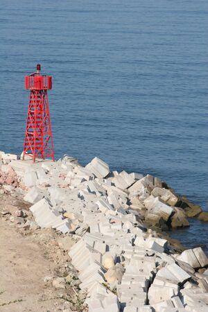 Warning beacon on rocky coast Stock Photo - 408938