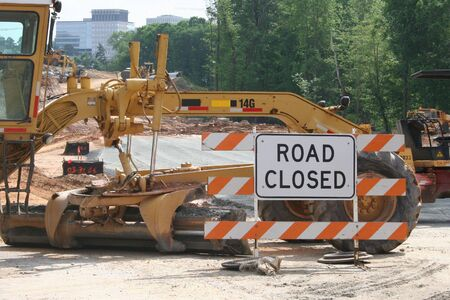 Road Closed sign and construction equipment
