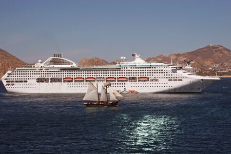 Cruise Ship and Sail Boat Banco de Imagens