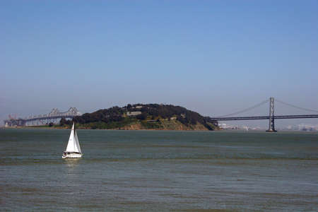 oakland: Sailboat in Oakland Bay with Bay Bridge in Background