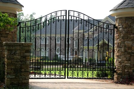 stately home: Brick mansion behind iron gate