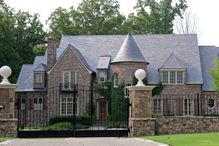 Stone mansion behind iron gate Stock Photo - 475057