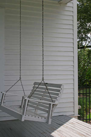 Old wooden porch swing