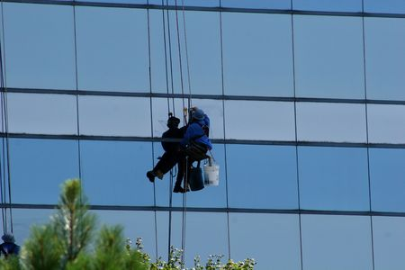 Window washer on side of highrise