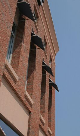 awnings: Modern brick building with awnings