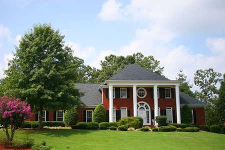 Nice brick house on street Stock Photo - 509785