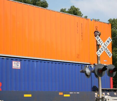 freight train: Orange and blue freight train cars Stock Photo