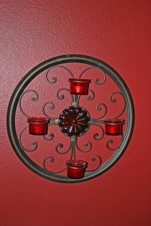 sconce: Candle holders on red wall Stock Photo