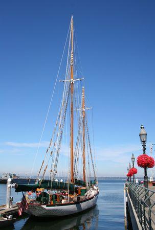 Sailing ship docked at pier