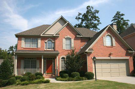 Nice brick house and blue sky