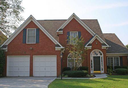 Nice brick house and blue sky Stock Photo - 557931