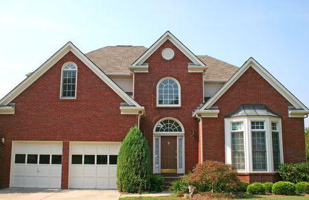 A Nice brick house and blue sky Stock Photo - 559820