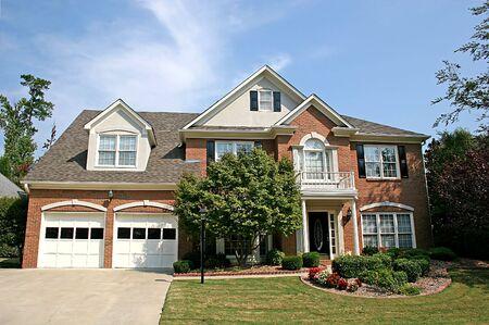 A Nice brick house and blue sky Stock Photo