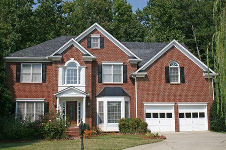 A nice brick house against a blue sky Stock Photo - 566180