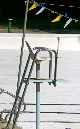 Empty lifeguard chair at empty pool
