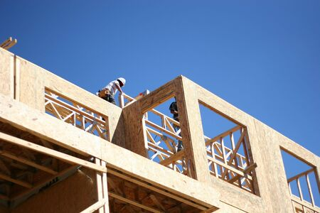 joist: Carpenters working on wood frame condominium complex Stock Photo