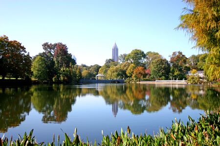Lake in city park with skyline in background