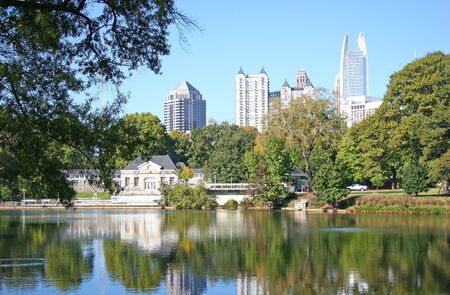 Reflection of city skyline in lake at urban park