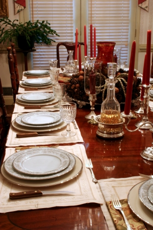 Formal dining table in home set for holiday dinner photo