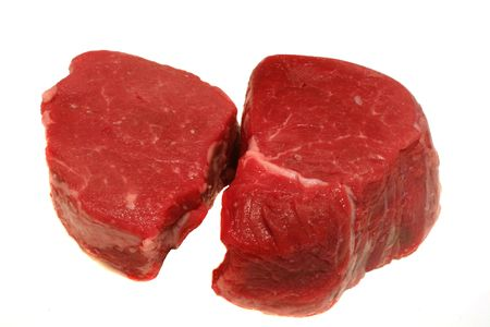 Two prime filet mignon steaks ready for grilling isolated on white Stock Photo - 610579