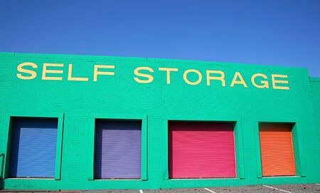 self storage: Colorful self storage warehouse with blue sky in background