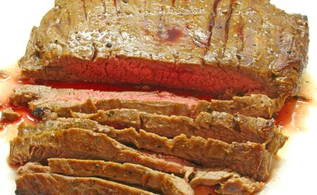 A nice cut of flank steak roasted rare and sliced photo