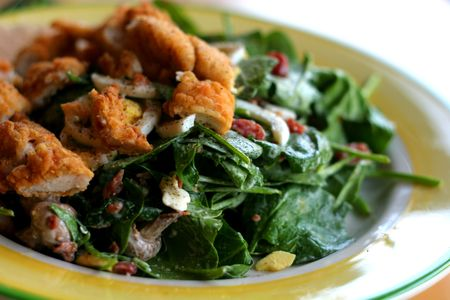 tender's: Close up of a green spinach salad with chickent tenders