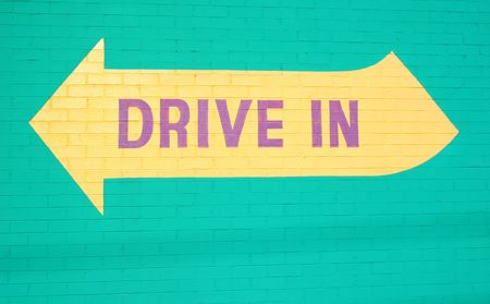 self storage: Colorful drive in sign at self storage location Stock Photo