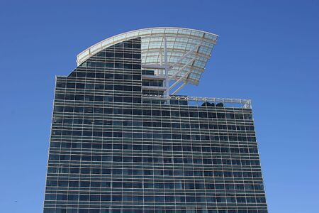 Modern Blue Glass building with curved roof against sky Stock Photo - 658695