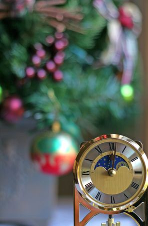 past midnight: Anniversary clock at one minute past midnight with Christmas tree in background