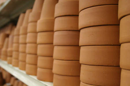 Stacks and rows of clay pots in a retail store Stock Photo
