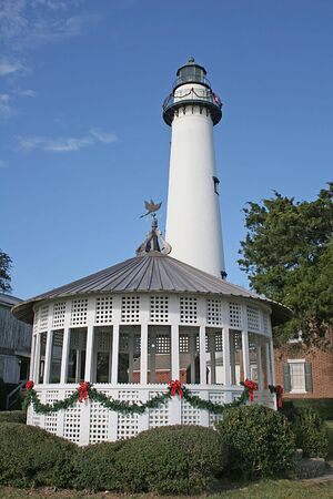 A lighthouse and gazebo at coast decorated for Christmas Stock Photo - 674317