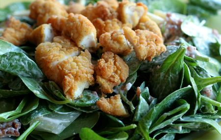 topped: Healthy spinach salad topped with chicken tenders