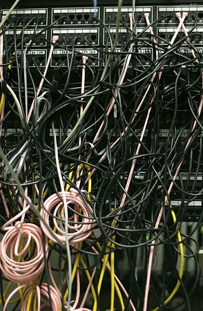 disarray: A disarray of multi-colored Phone cables in a wiring closet