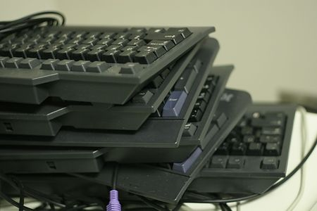 A stack of old, dusty, used keyboards Stock Photo - 687965