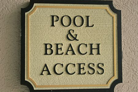 Pool and Beach Access sign at resort