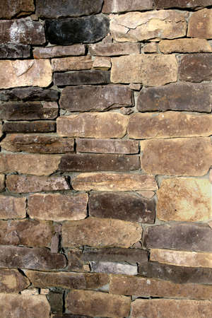 A stone and masonry wall useful for backgrounds and textures photo