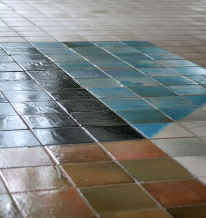 Ceramic tile floor with interesting pattern fading into the distance Stock Photo - 705821
