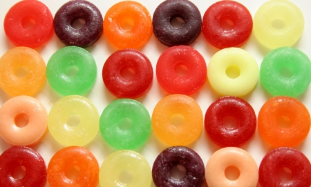 savers: Colorful round candies with hole in middle on white background